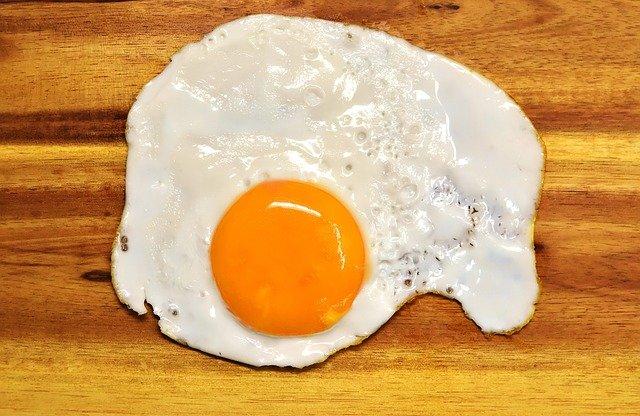 A fried egg, yolk on show.